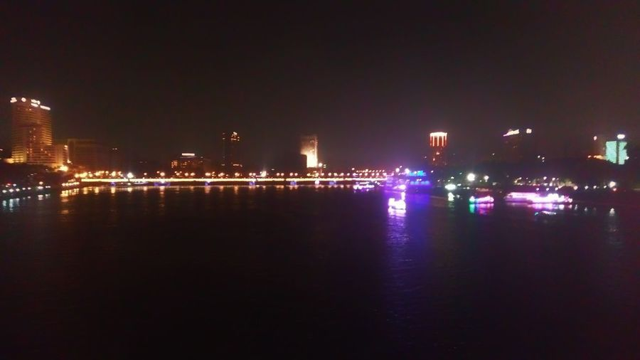Night Illuminated Reflection Celebration Outdoors Water Arts Culture And Entertainment Building Exterior Architecture No People Multi Colored Nautical Vessel Industry Nightlife City Sky Cityscape Nile River Egyptdailylife This Is Egypt ❤ Photographing Full Length Built Structure Ancient City