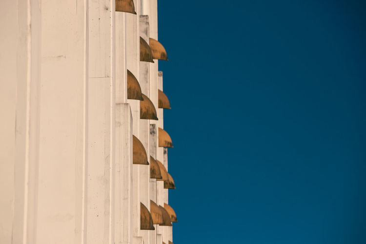 © Edi Libedinsky | instagram: https://www.instagram.com/edilibedinsky/ Web: www.edilibedinsky.com Apartment Architecture Blue Building Building Exterior Built Structure Clear Sky Close-up Copy Space Day Directly Below In A Row Low Angle View Nature No People Outdoors Pattern Residential District Sky Sunlight Wall - Building Feature Wood - Material