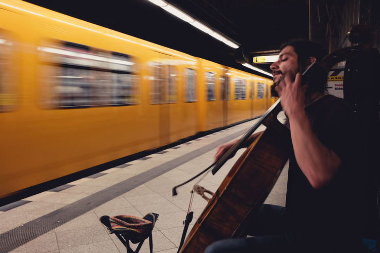 yellow and cello Adult Berlin Blurred Motion BVG - Berliner Verkehrsgesellschaft Cello Musical Instrument Men Motion Musician One Person The Street Photographer - 2017 EyeEm Awards Public Transportation Rail Transportation Railroad Station Real People Speed Streetmusician Streetphotography Subway Train Train - Vehicle Transportation Underground Yellow Young Adult First Eyeem Photo The Street Photographer - 2017 EyeEm Awards The Street Photographer - 2017 EyeEm Awards Paint The Town Yellow Paint The Town Yellow