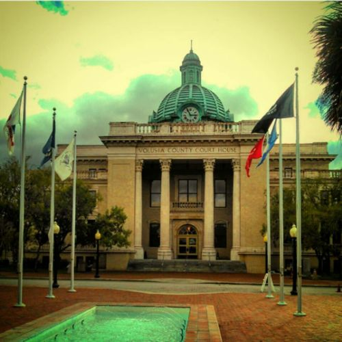 The City Light Flag Government Architecture Patriotism Building Exterior Politics And Government Travel Travel Destinations Sky Politics History Façade Architectural Column City Built Structure Outdoors Cloud - Sky No People Cultures Deland Volusia County Florida Historical Building Historic Downtown Small Town USA
