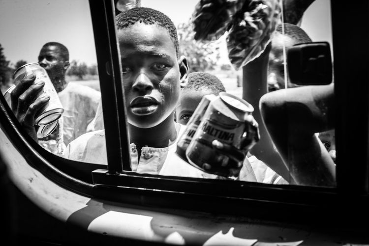 #urbanana: The Urban Playground Boko Haram Hopeless Nigeria The Week on EyeEm Beeing Stuck Black And White Dangerous Places Documentary Hopelessness Inside And Outside Lifestyles Migration Trail Monochrome On The Way To Sokoto Photography Themes Poor And Rich Poor People  Refugee Route Reportage Roadseller Social Issues Teenager
