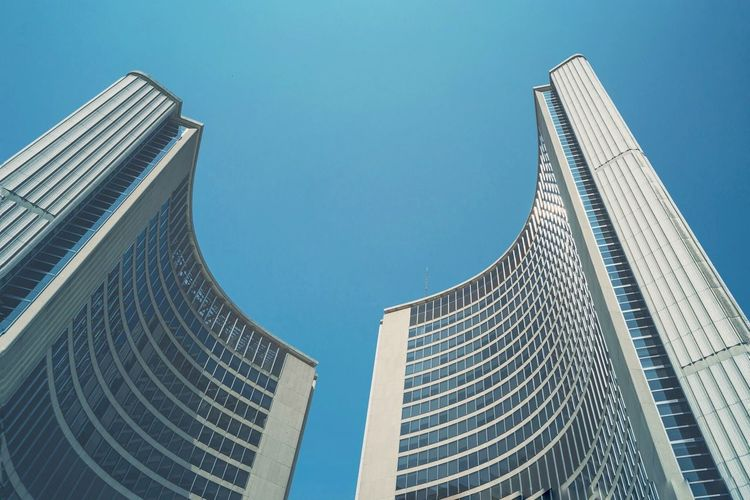 Low Angle View Of Modern Buildings Against Clear Blue Sky