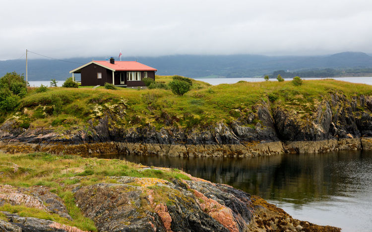 Landscape of Norway, Atlantic Ocean Road. Atlantic Road Eide Norway Travel Architecture Atlantic Ocean Road Beauty In Nature Building Building Exterior Built Structure Cloud - Sky Day Grass House Land Luxury Nature No People Norway Nature Outdoors Residential District Rock Scenics - Nature Sea Sky Tranquility Water