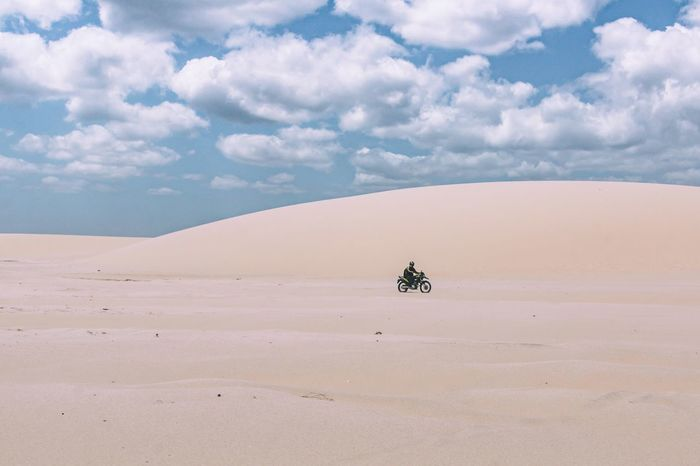 Crossing the desert. Arid Climate Beauty In Nature Bike Cloud - Sky Day Desert Landscape Minimal Minimalism Motorcycle Nature One Man Only One Person Outdoors Remote Sand Sand Dune Scenics Tranquil Scene Tranquility Transportation Travel Travel Destinations Travel Photography Traveling The Great Outdoors - 2017 EyeEm Awards The Photojournalist - 2017 EyeEm Awards EyeEmNewHere Let's Go. Together. Sommergefühle EyeEm Selects Connected By Travel An Eye For Travel This Is Masculinity Going Remote Focus On The Story Visual Creativity The Great Outdoors - 2018 EyeEm Awards The Traveler - 2018 EyeEm Awards