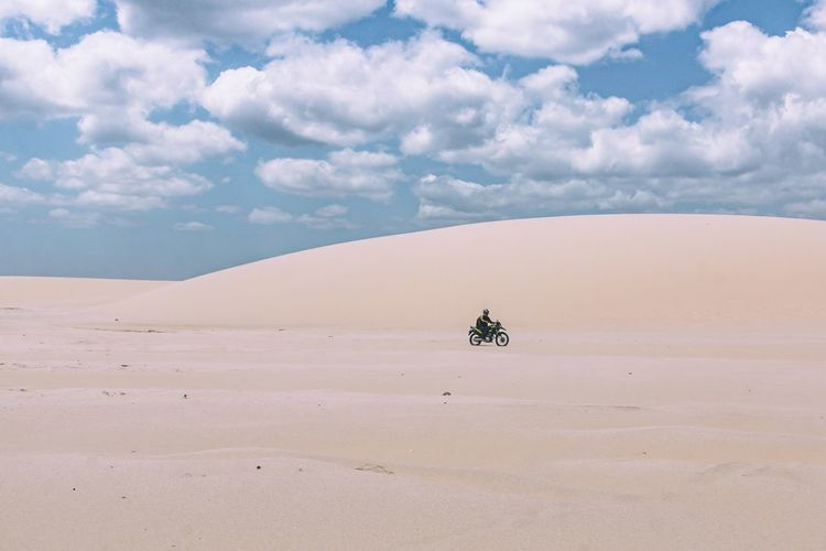 Crossing the desert. Arid Climate Beauty In Nature Bike Cloud - Sky Day Desert Landscape Minimal Minimalism Motorcycle Nature One Man Only One Person Outdoors Remote Sand Sand Dune Scenics Tranquil Scene Tranquility Transportation Travel Travel Destinations Travel Photography Traveling The Great Outdoors - 2017 EyeEm Awards The Photojournalist - 2017 EyeEm Awards EyeEmNewHere Let's Go. Together. Sommergefühle EyeEm Selects Connected By Travel An Eye For Travel This Is Masculinity Going Remote Focus On The Story Visual Creativity The Great Outdoors - 2018 EyeEm Awards The Traveler - 2018 EyeEm Awards A New Beginning A New Perspective On Life Capture Tomorrow 2018 In One Photograph