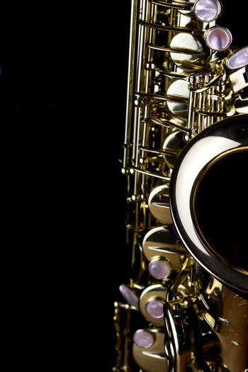 Music Instrument Alto Saxophone, Saxophone Isolated on black Musical Instrument Studio Shot Music Arts Culture And Entertainment Close-up Metal Black Background Indoors  Wind Instrument Brass Instrument  Jazz Music No People Shiny Brass Gold Colored Copy Space Single Object Still Life Musical Equipment Saxophone Trumpet
