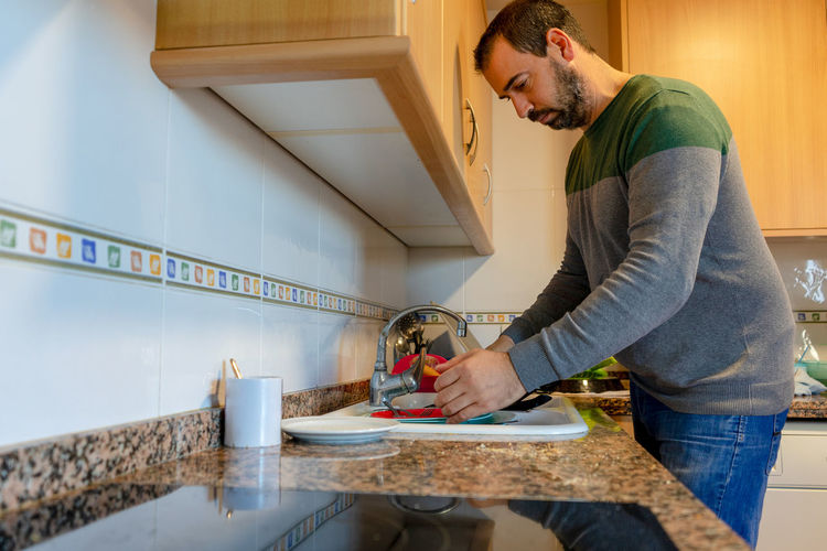 Side view of man working at home