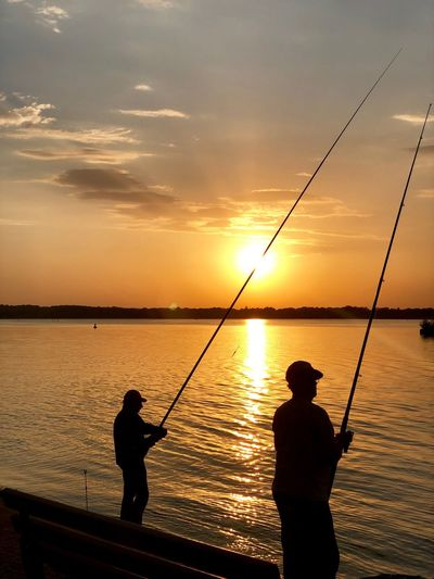 Sunset Sunset Sky Silhouette Fishing Fishing Rod Water Rod Beauty In Nature Scenics - Nature Leisure Activity Real People Sea Nature Cloud - Sky