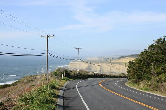 California Cliff Exploring Travel Destinations Travel Rural Scene Nature Coastline Trees Bend In The Road Ocean Sunny High Way Day Road No People The Way Forward Outdoors Sky Telephone Line Tree