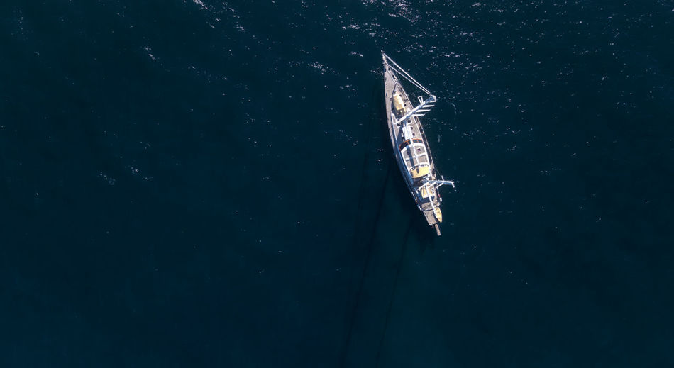 Aerial drone view of a yacht boat on ocean