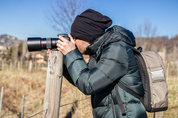 Nature photographer in action with macro lens. 100mm Macro Adventure Background Camera Digital DSLR Equipment Fun Hobbyphotography Job Landscape Lens Man Nature Photography Outdoors People Photographer Professionalphotography Shot Tourism Travel Zoom