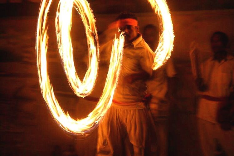 Photography In Motion Nepal Chitwan man fire dancing motion culture