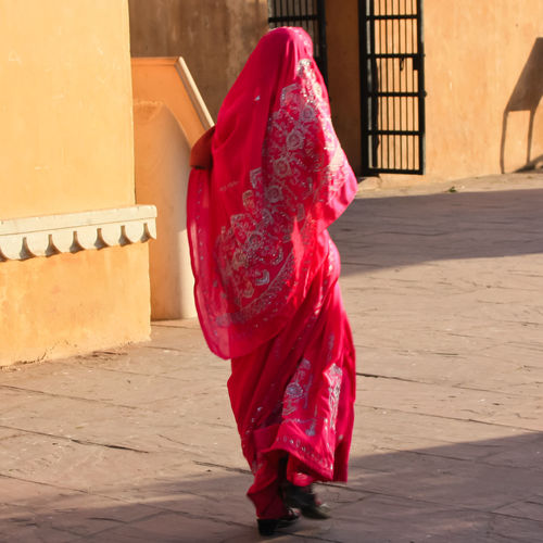 India woman in traditional red dress Architecture One Person Traditional Clothing Full Length Clothing Real People Built Structure Red Pink Color Day Women Standing Walking Building Outdoors Dress