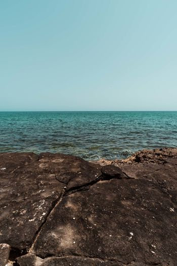 Oman Chapters Sea Water Horizon Over Water Sky Beauty In Nature Horizon Scenics - Nature Tranquility Tranquil Scene Blue Copy Space Clear Sky No People Nature Day Idyllic Beach Land Non-urban Scene Outdoors Turquoise Colored
