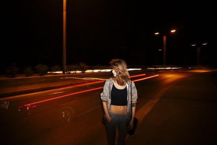 Full length of light trails on street at night
