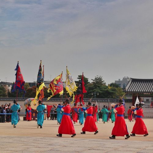 changing of guards ceremony Cultures Travel Destinations Large Group Of People Red Architecture Day Outdoors Gyeongbokgung Palace, Seoul Gyeongbokgung Palace Changing Of The Guards Ceremony Changing Of The Guards Seoul South Korea