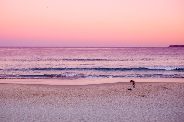 Adult Australia Beach Beauty In Nature Color Freedom Full Length Horizon Horizon Over Water Millennial Pink Nature One Person One Woman Only Outdoors People Pink Pink Color Sand Sea Sky Sunset Swimming Tranquility Waves Woman The Great Outdoors Lost In The Landscape