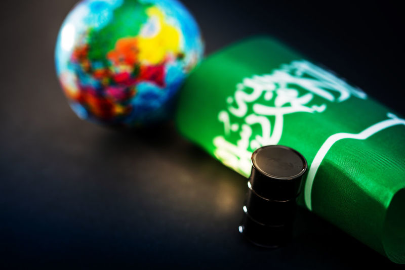 Crude OPEC Art And Craft Barrel Black Background Celebration Close-up Creativity Crisis Focus On Foreground Globe - Man Made Object Green Color High Angle View Indoors  Multi Colored Nature No People Oil Selective Focus Single Object Sphere Still Life Studio Shot Table