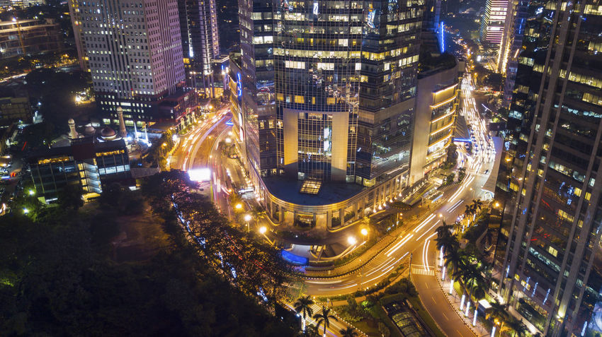 Architecture Building Building Exterior Built Structure City City Life Cityscape Financial District  High Angle View Illuminated Long Exposure Modern Motion Night Nightlife No People Office Building Exterior Outdoors Road Skyscraper Street Transportation
