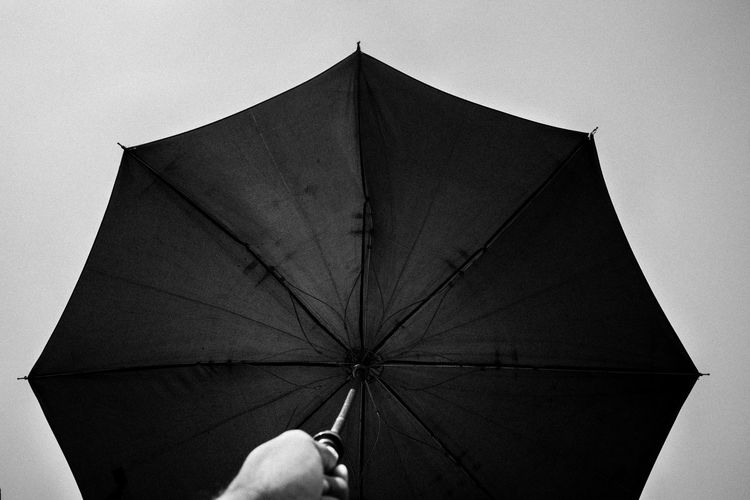 Being in the shades will turn your life into black and white, Go out feel the rain, experience something new - ✍️Code Nemesis✍️ Umbrella Umbrellas Umbrell In Sky Open Umbrella Fine Art Art Photography Still Life No People Fine Art Photography Hands Metallic Fingers Black And White Monochrome Photography Blackandwhite Human Hand Monochrome Human Body Part Blue Hand Holding An Umbrella Octagon Metal Rain Black Black Umbrella Lieblingsteil Black And White Friday Be. Ready. AI Now