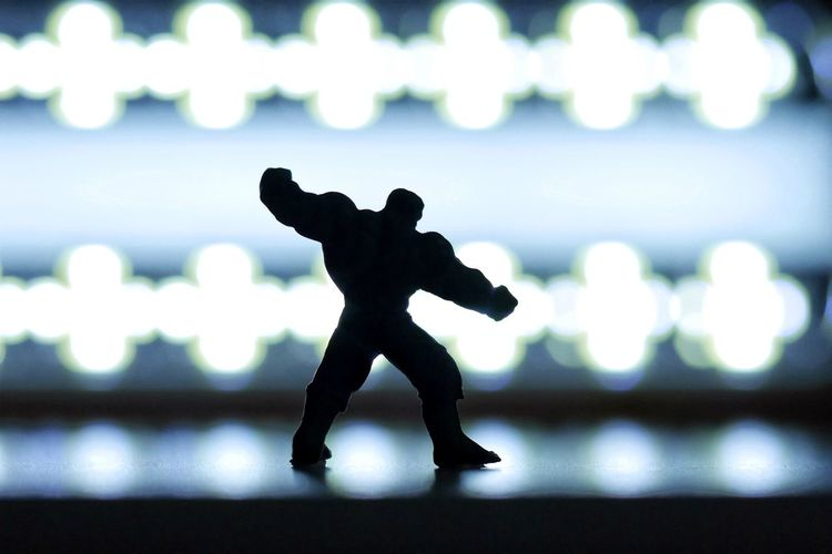 Close-up of silhouette figurine on table