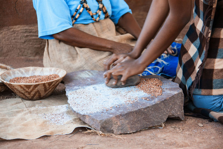 Midsection of woman grinding seeds