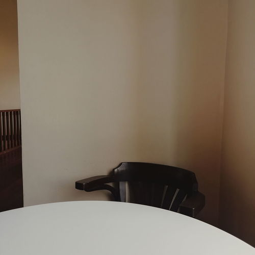 Empty chair by table at home