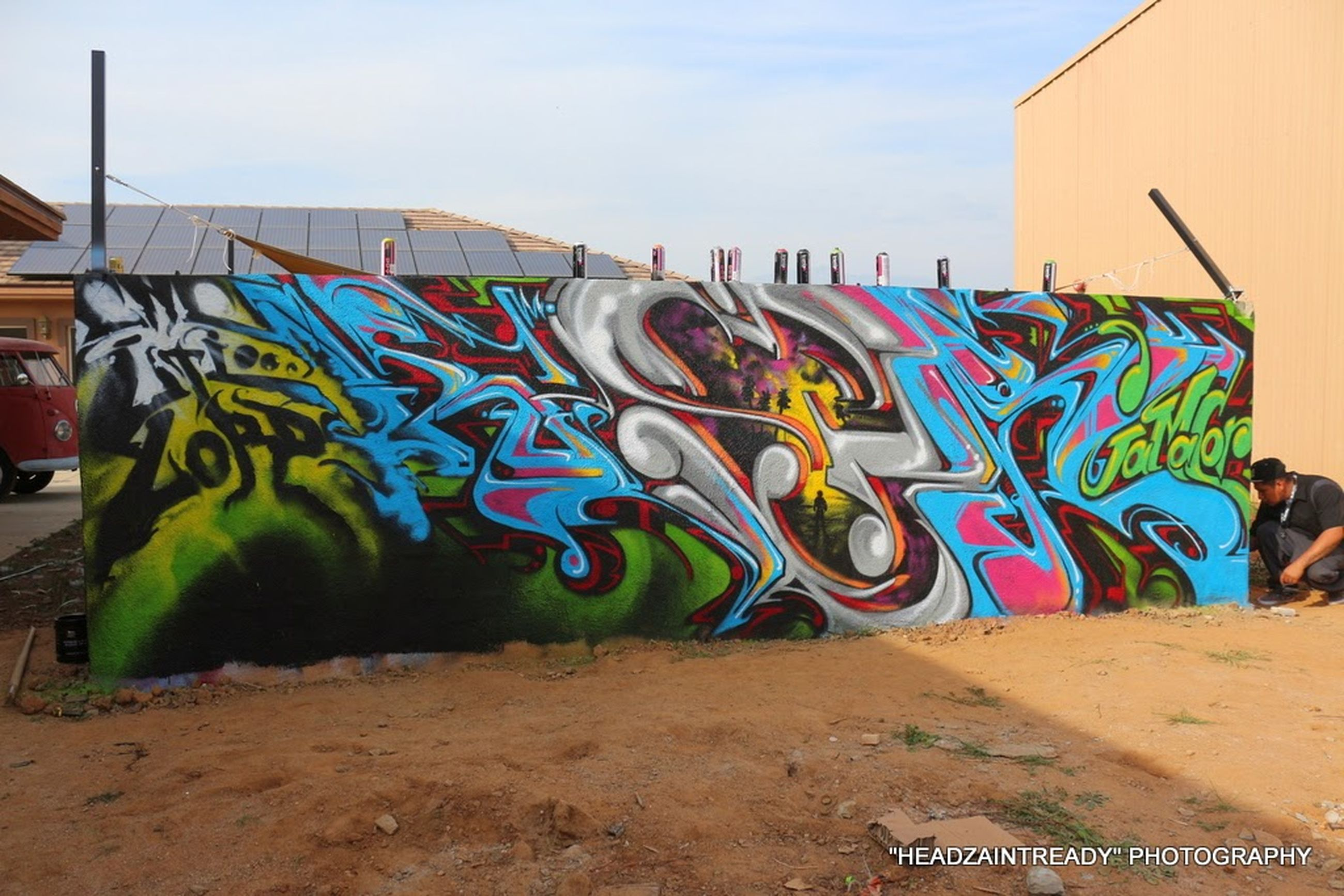 graffiti, art, creativity, art and craft, multi colored, built structure, architecture, building exterior, wall - building feature, street art, text, human representation, western script, wall, day, animal representation, no people, outdoors, blue, communication