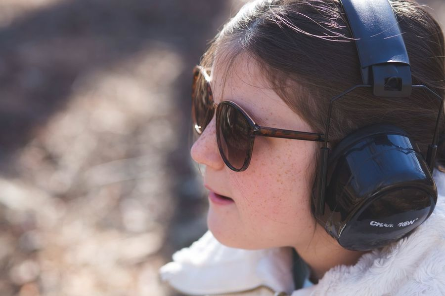 Gun Range EyeEm Selects Sunglasses Headshot One Person Real People Focus On Foreground Childhood Leisure Activity People Close-up Day Outdoors
