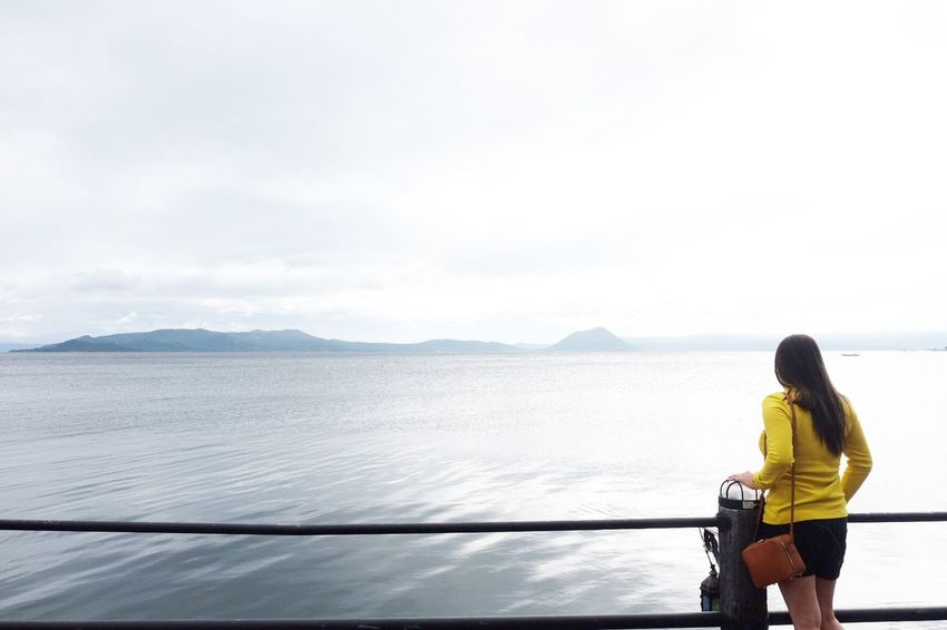 Peace And Tranquility Solitude By The Water Solitude Tourist Destination Tourist Attraction  Tagaytay, Philippines Club Balai Isabel Taal Lake Water Sky Real People Beauty In Nature Mountain Sea Rear View Nature One Person Outdoors Looking At View Non-urban Scene