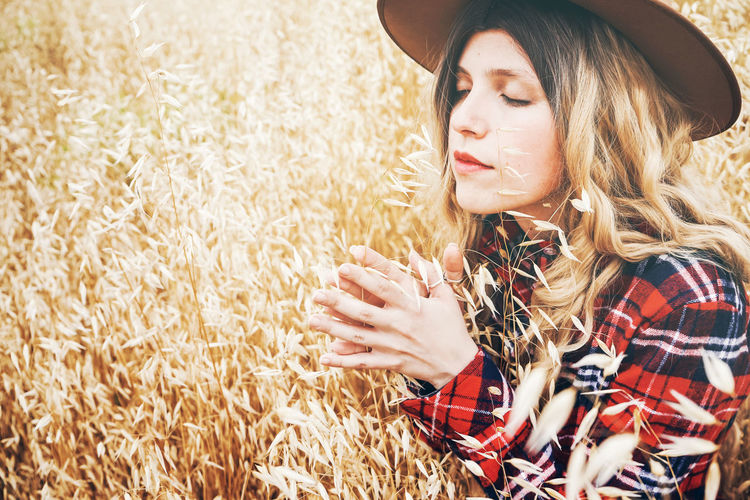 One Person Young Adult Hat Hair Clothing Young Women Adult Lifestyles Farm Hairstyle Agriculture Plant Real People Leisure Activity Crop  Day Rural Scene Beauty Beautiful Woman Outdoors Countryside Silence Scene