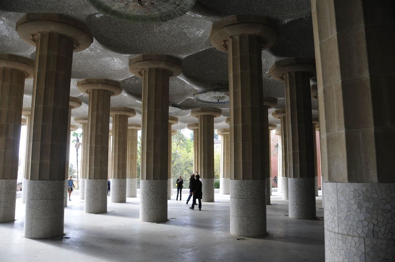 Park Güell Säulen Public Building Architectural Column Architecture Built Structure Building Arcade The Past History Real People Walking Corridor Colonnade Full Length Indoors  Men In A Row Arch People Lifestyles Rear View Passage Column Pillar Arched Historic Building Archway Hallway Passageway Monument