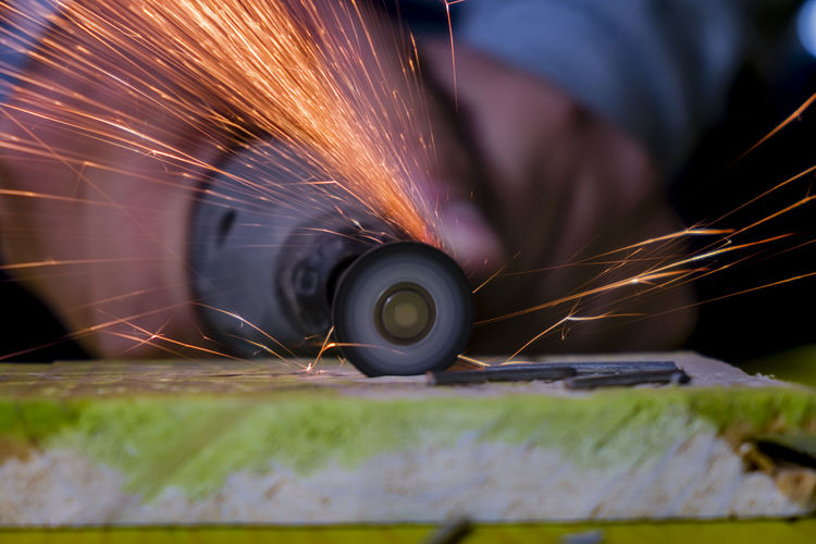 Craftsperson cutting wood from electric saw