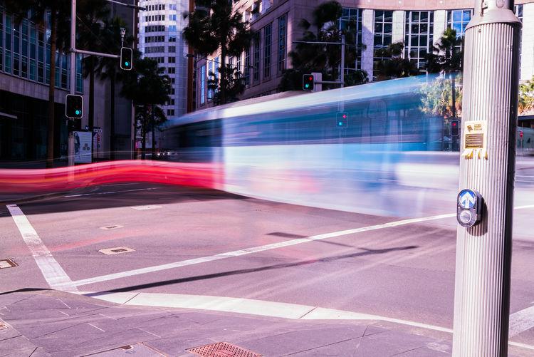 Long exposure of bus on street in city