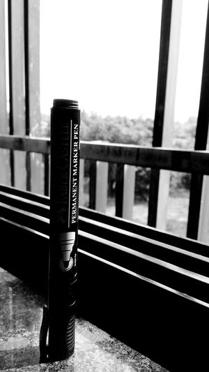 Close-up of text on railing by window