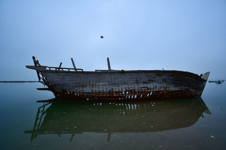 old ship wreck Coastline Old Ship SeaScapePhotography Ships At Sea Animal Themes Beauty In Nature Clear Sky Day Mode Of Transport Nature Nautical Vessel No People Old Ship Wreck Outdoors Sea Ship At The Shore Ship Wreckage Ship Yard Ships Ships On The Water Shipwreck Sky Sunken Transportation Water