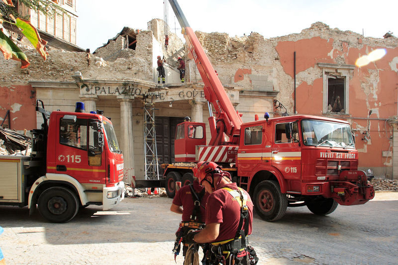 Firefighters and mobile cranes in front of the town hall after the Aquila earthquake L'Aquila Rubble Wall Architecture Building Exterior Built Structure City Earthquake Earthquake Area Earthquake In Italy Earthquake L'aquila Fire Engine Firefighters Firefighters In Action Land Vehicle Men Mobile Cranes Mode Of Transport Outdoors Real People Red Rubble Transportation