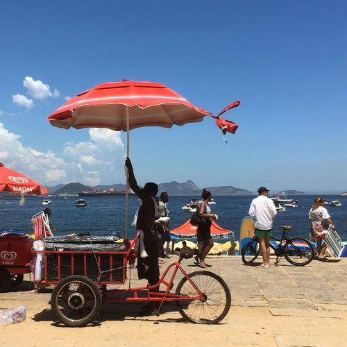 Vermela beach, Urca - Rio de Jameiro Urca Beach Beach Flag Transportation Mode Of Transport Outdoors Day Real People Leisure Activity Sky Bicycle Water Lifestyles Clear Sky