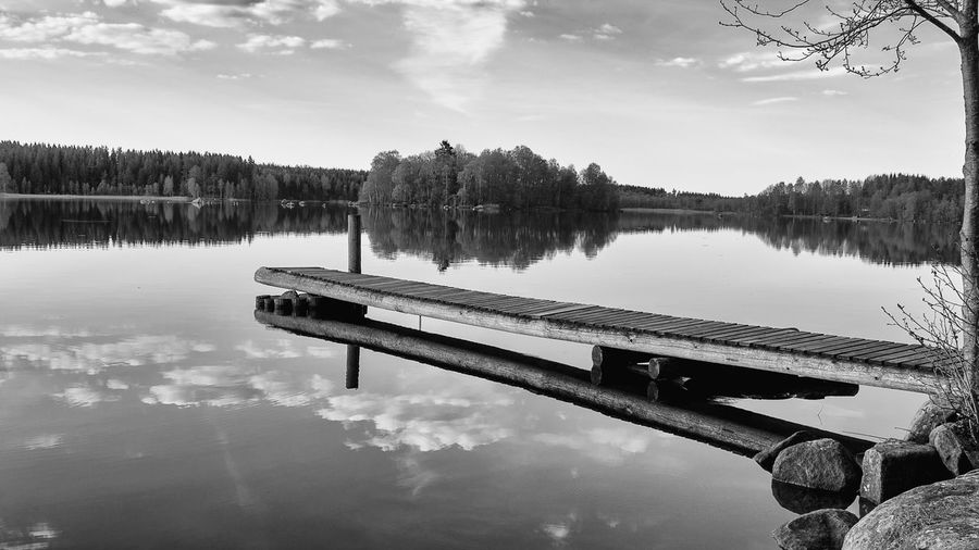 Beauty In Nature Black & White Black And White Day Exceptional Photographs First Eyeem Photo Hello World Jetty Lake Lake View Lakeshore Lakeside Lakeview Miles Away Nature No People Outdoors Reflection Reflection Lake Scenics Sky Standing Water Tranquility Tree Water Live For The Story