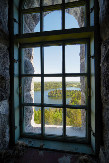 Landscape view through a window at Aulanko lookout tower in Finland. Aulanko Building Distant View Finland Hämeenlinna Interior Interior Views Interiors Lake Scenery Lake View Landscape Nature Nature Park  Nature Reserve Summer Summertime Tower View View Through The Window Window View