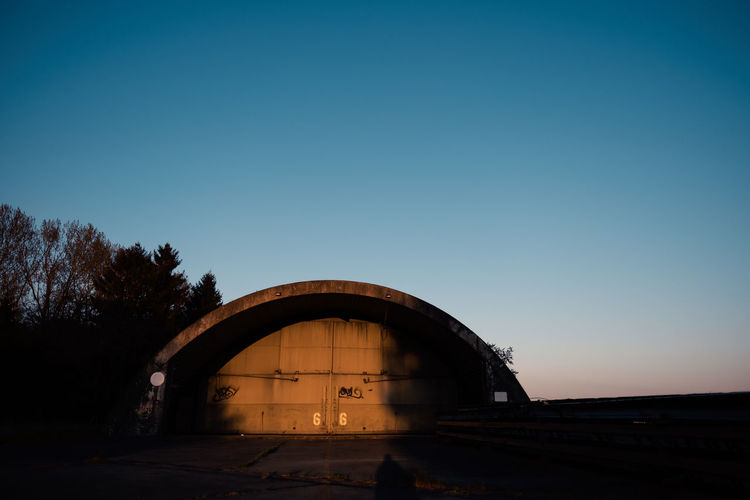 VAULT 66 Sky Architecture Arch Clear Sky Built Structure Copy Space Nature Transportation No People Blue Building Exterior Dusk Sunset Outdoors Day Silhouette History Entrance Tree The Past Shelter Vault