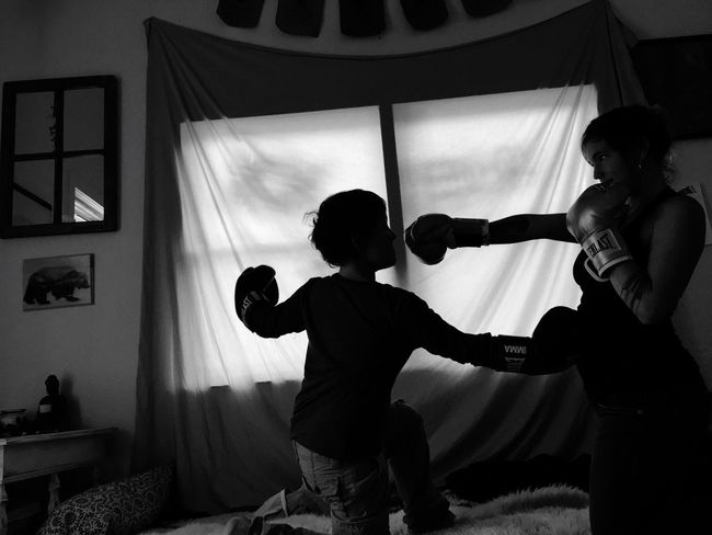 Knockout 👊🏻 Two People Mom And Son Fight Kickboxing Training Blackandwhite Real People Home Interior Boys Indoors  Childhood Lifestyles Domestic Life Leisure Activity Standing Playing Day Domestic Room Togetherness Eye On The Prize