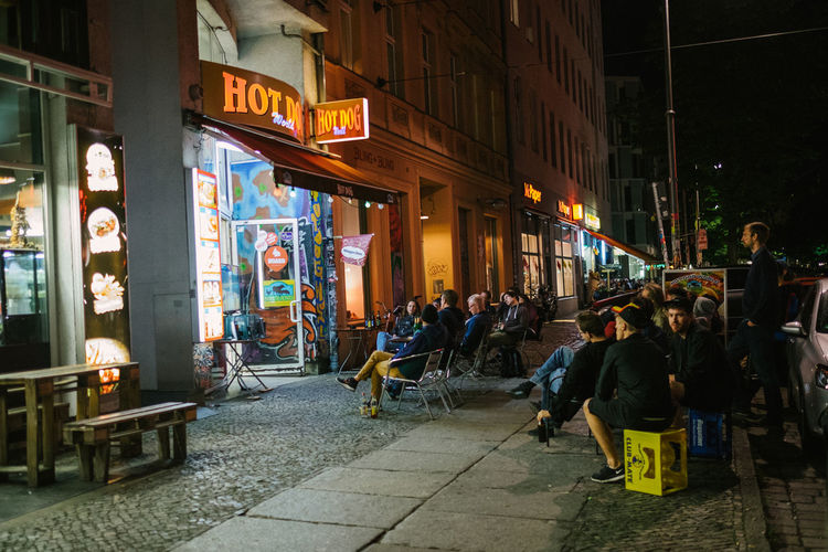 Locals spilling into the sidewalks as they watch the Euro Cup finals. Berlin Capture Berlin City Deutschland Germany Illuminated Large Group Of People Night Outdoors Restaurant Street