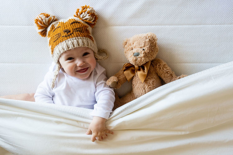 Portrait of cute baby toy