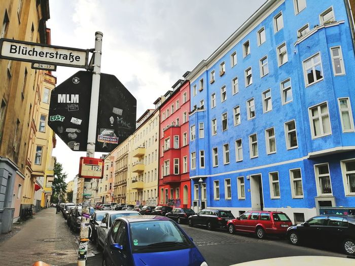 Berlin is awesome. Colorful Color Building Berlin Straße Straße Germany Berlin Photography City Road Sign Car Street City Street Land Vehicle Sky Architecture Building Exterior Built Structure Information Sign Signboard Information Road Signal Board The Traveler - 2019 EyeEm Awards