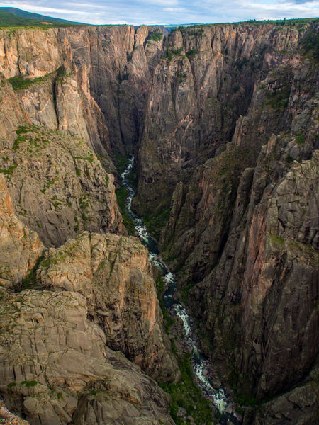 A view of the canyon and river in Black Canyon of the Gunnison National Park, Colorado. Black Canyon Of The Gunnison National Park Black Canyon Of The Gunnison Colorado Nature Adventure Black Canyon Canyon Cliff Day Gunnison River Landscape Mountain Nature No People Outdoors Ravine River Rock - Object Scenics