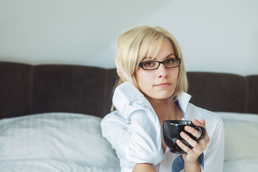 Young Blond Woman In The Morning In Bed At Home Beautiful Coffee Happy Morning Reading Relaxing Woman Attractive Bed Bedroom Book Caucasian Cup Enjoying Life Female Friendly Indoors  Legs One Person Pretty Sheets Smiling White Young Adult