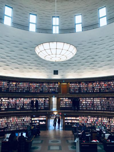 Library Stockholm Architecture ShotOnIphone Books Indoors  Architecture Large Group Of People Built Structure Day Illuminated Time Leisure Activity Women Men City Clock Lifestyles Adult Ceiling