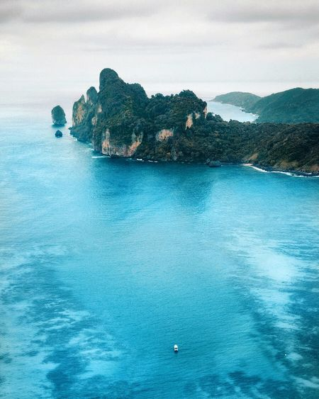 Phi Phi Bay Boatlife Speedboat Dronephotography Drone  Thailand Boats Phi Phi Bluesea Paradise Beach Island Beach Karst Paradise Mountains Cliffs Maya Bay Maya Bay Phi Phi Islands Water Sea Beauty In Nature Scenics - Nature Tranquil Scene Tranquility Sky Nature Blue Waterfront Rock - Object Rock Formation Outdoors