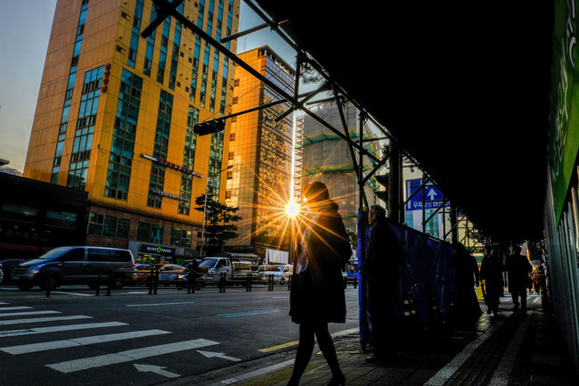 a sunset in a city Cityscape Cityscapes Pedestrian Shillouette Shillouettes And Sunshine Street Streetphotography Way Home From Work